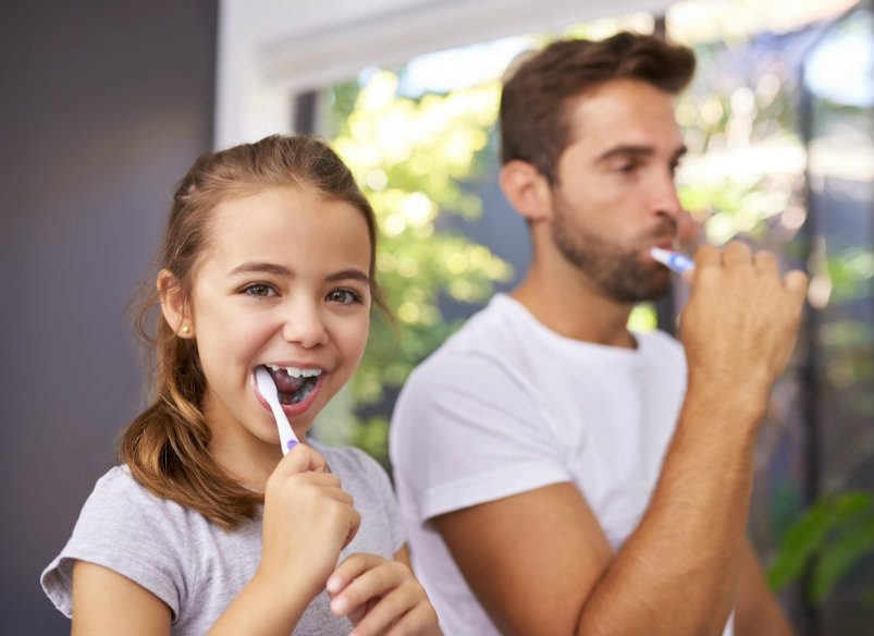 father and dauther dental care