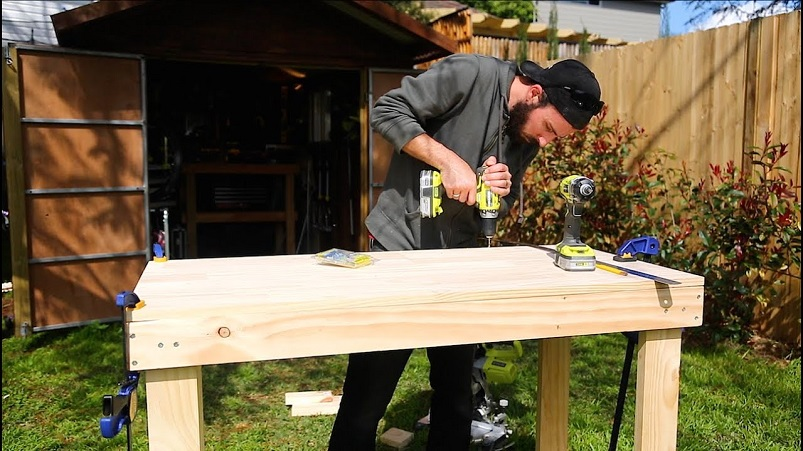 working on workbench in garden shed